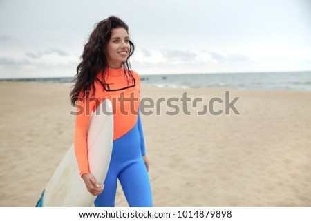 surfer girl on the beach  #1014879898