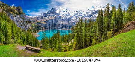 Amazing tourquise Oeschinnensee with waterfalls and Swiss Alps, Kandersteg, Berner Oberland, Switzerland. Royalty-Free Stock Photo #1015047394