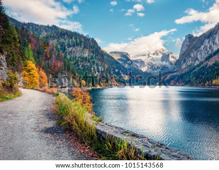 Colorful autumn scene of Vorderer (Gosausee) lake with Dachstein glacier on background. Fabulous morning view of Austrian Alps, Upper Austria, Europe. Orton Effect.  #1015143568
