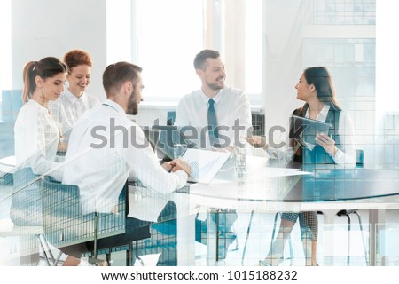 Double exposure of cityscape view and people working at table in office. Concept of financial trading Royalty-Free Stock Photo #1015188232