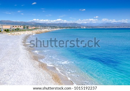 French Riviera, an empty pebbly beach near azure clear water.  #1015192237
