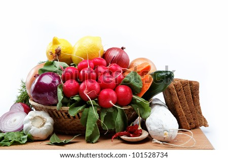 Healthy food. Fresh vegetables and fruits on a wooden board. #101528734