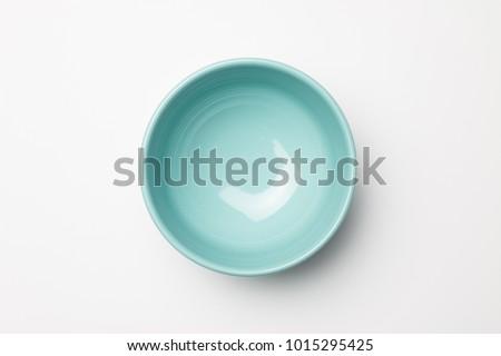 Blue bowl on white background Royalty-Free Stock Photo #1015295425