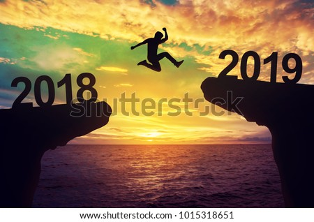 Man jump between 2018 and 2019 years. #1015318651