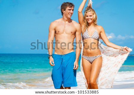 Attractive Couple Walking on Beautiful Beach #101533885