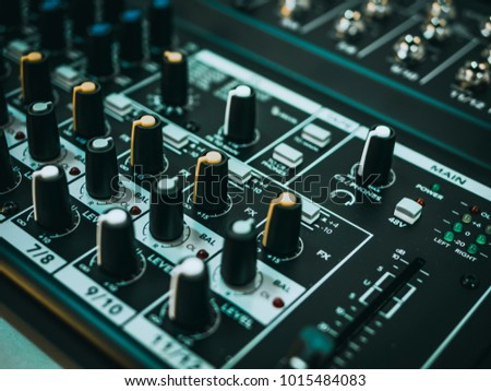 Professional audio equipment for sound recording studio faders volume regulators on midi piano #1015484083