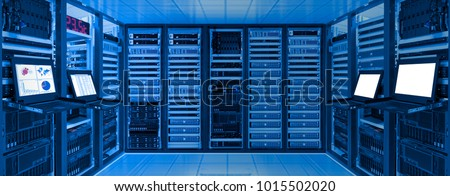 Data center room with server and networking device on rack cabinet, kvm monitor screen display chart, log and blank screen #1015502020
