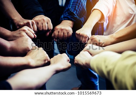 Group of people joining their hands. Teamwork concept. #1015569673