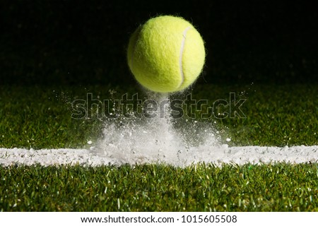 Match point with a tennis ball hitting the line #1015605508