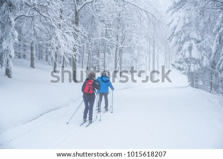 Retire couple have active time in white snowy winter nature, old people sports together #1015618207