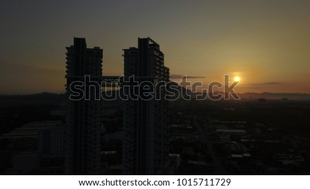 Construction of high-rise buildings on backgroun sunrise #1015711729