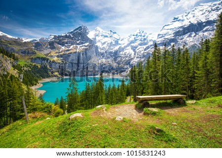 Amazing tourquise Oeschinnensee with waterfalls and Swiss Alps, Kandersteg, Berner Oberland, Switzerland. Royalty-Free Stock Photo #1015831243