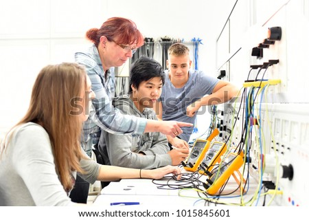 Group of young people in technical vocational training with teacher  Royalty-Free Stock Photo #1015845601