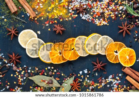 set of dried fruits and candied fruit for mulled wine with lemon, orange on a blue wooden background.