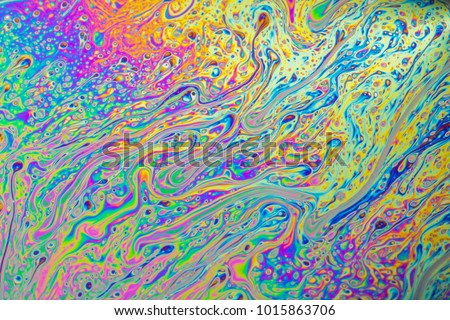 Psychedelic abstract formed by light interference on the surface of a soap bubble