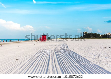 Multi-Colored Life Guard huts on the white pearl sand. #1015873633