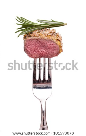 White isolated saddle of lamb with thyme on a fork #101593078