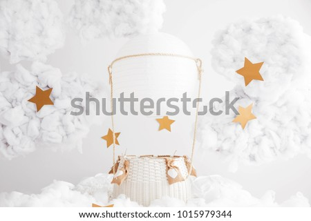 Digital background for newborn and children photography. White hand made air balloon in the clouds with the stars. White clouds. Valentines day decorations.