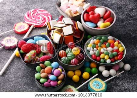 candies with jelly and sugar. colorful array of different childs sweets and treats Royalty-Free Stock Photo #1016077810