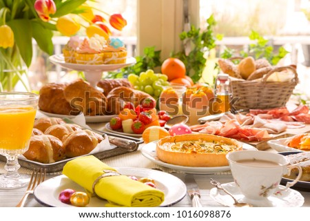 Breakfast or brunch table filled with all sorts of delicious delicatessen ready for an Easter meal. #1016098876