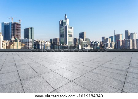empty marble floor with panoramic cityscape #1016184340