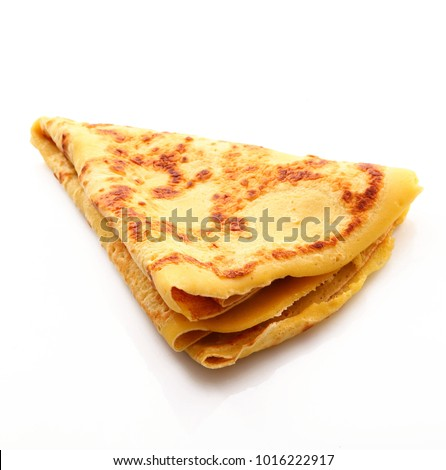 french crepes on white background Royalty-Free Stock Photo #1016222917