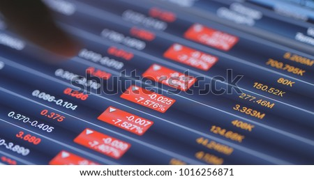 Recession of stock market on tablet computer  Royalty-Free Stock Photo #1016256871