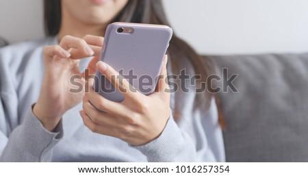 Woman using mobile phone  #1016257354