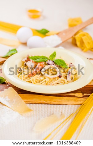 Spaghetti with seafood and parmesan cheese in beige plate #1016388409