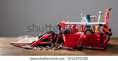 Toolbox With Different Worktools Against Grey Background #1016392180