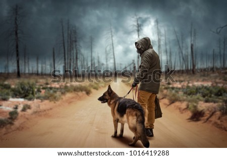 Stalker and dog, survivors after nuclear war Royalty-Free Stock Photo #1016419288