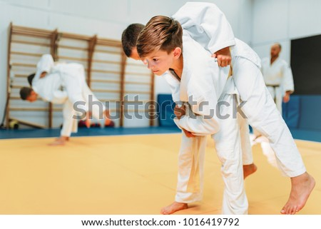 Kid judo, young fighters on training, self-defense #1016419792