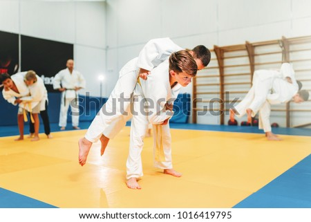 Kid judo, young fighters on training, self-defense Royalty-Free Stock Photo #1016419795