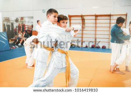 Kid judo, childrens training martial art in hall Royalty-Free Stock Photo #1016419810