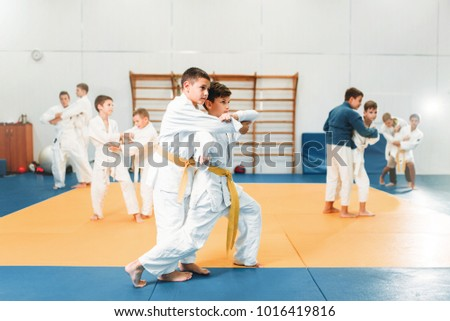 Kid judo, childrens training martial art in hall Royalty-Free Stock Photo #1016419816