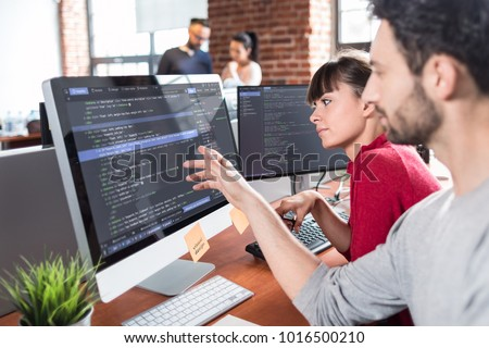 Developing programming and coding technologies. Website design. Programmer working in a software develop company office. Royalty-Free Stock Photo #1016500210