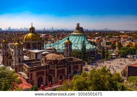 Mexico. Basilica of Our Lady of Guadalupe. The old and the new basilica, cityscape of Mexico City on the far #1016501671