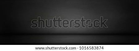Black, dark and gray abstract  cement wall and studio room gradient background