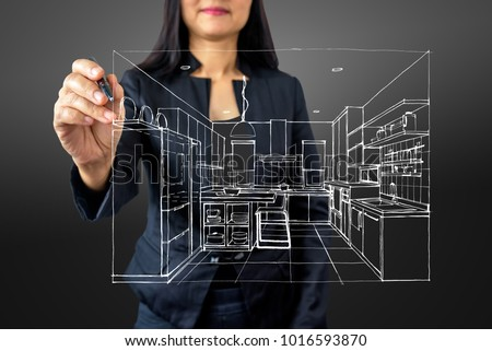 Businesswoman (Architect / Interior designer) drawing 3D Kitchen on modern futuristic virtual screen