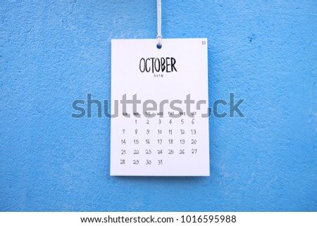 Vintage calendar 2018 handmade hang on the blue wall, October 2018 #1016595988