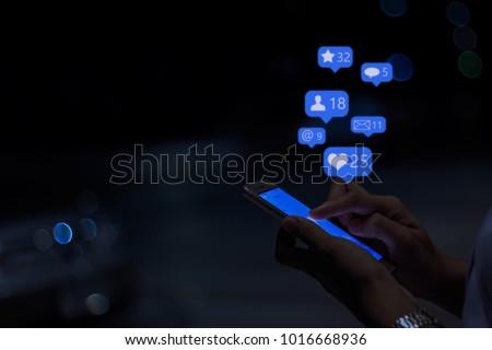 Young girl using smart phone at night ,Social media concept.