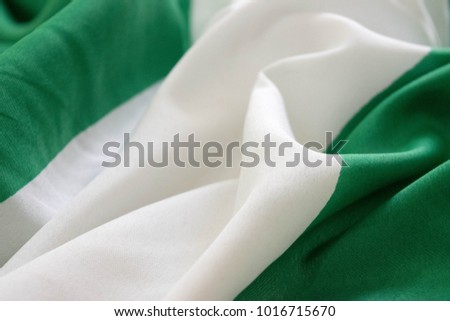 Nigerian National flag close up in folds and and ruffles for independence day concept and desktop presentation background  #1016715670