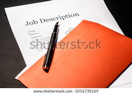Job description and golden pen on the envelope for letters #1016730169