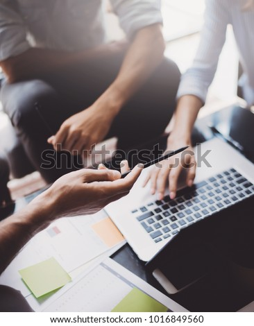 Closeup view of teamwork proccess.People hands, holding documents, typing laptop.Vertical Royalty-Free Stock Photo #1016849560