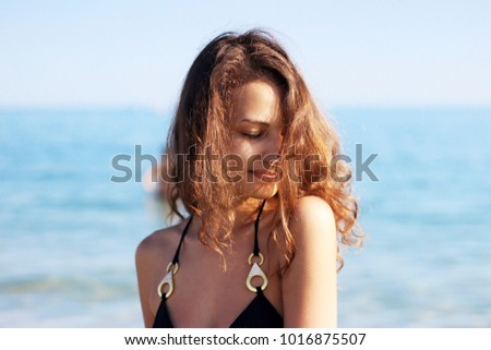 Portrait of the beautiful girl with fluttering hair close-up. #1016875507
