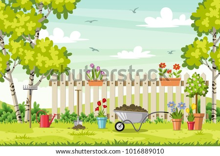 Spring landscape with garden tools