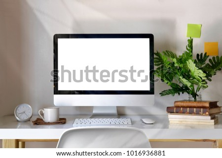 Mockup desktop computer, coffee mug, plant and accessories on desk, Workspace and blank screen desktop computer. #1016936881