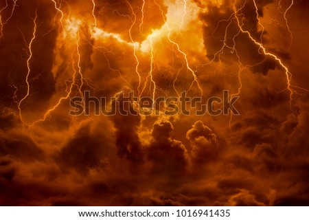 Dramatic religious background - hell realm, bright lightnings in dark red apocalyptic sky, judgement day, end of world, eternal damnation Royalty-Free Stock Photo #1016941435