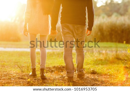 Young couple in love outdoor at sunset #1016953705