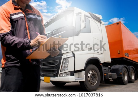 Truck inspection and safety, Truck driver daily checking the semi truck trailer. #1017037816